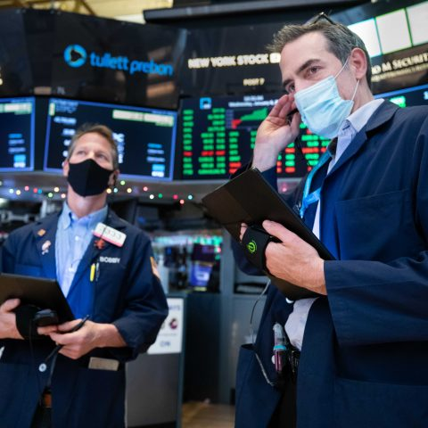 dow-jumps-400-points-to-close-at-a-record-amid-georgia-runoffs,-escalating-capitol-protests